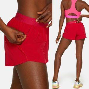 Outdoor Voices red relay shorts, zipper side